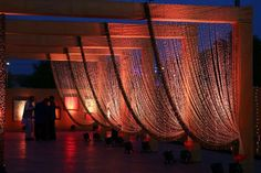 Love the rows of drawn crystals/beads with up lighting to create ambience.