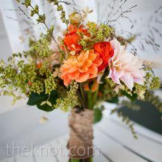 rustic bridesmaid bouquet with peegee hydrangeas, dahlias, ranunculus, berries and grasse