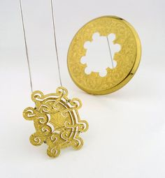 Melissa Cameron : stainless steel, 925 silver (made from antique gold plated powder case)