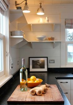 Vintage Wall Sconces, soapstone counter tops and open shelves.  I love the black soapstone, great contrast.