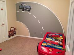My sons Disney Cars bedroom with road mural I painted. #Disney Cars Bedroom #toddler boys room