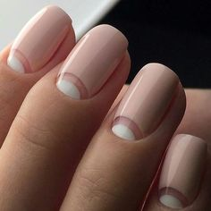 negative space manicure, pink and white nails. Reverse french manicure.