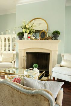Sherwin Williams Rainwashed Is One Of The Most Popular Green Blue Paint  Colours. Shown With Mantle With Spring Decor In A Living Room