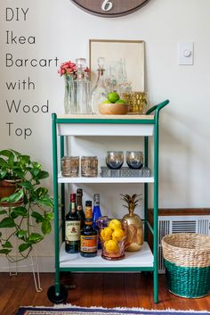 Ikea Bygel cart fixed up with a new wood top for less than $50! Makes a great bar cart.