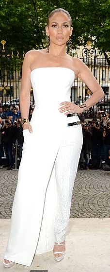 Jennifer Lopez wore a strapless white gown by the designer from the Fall 2014 Atelier Versace collection.