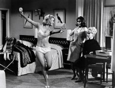 """Chris Noel does the fluffy slipper dance for Mary Ann Mobley and Joan O'Brien in """"Get Yourself a College Girl"""", 1964."""
