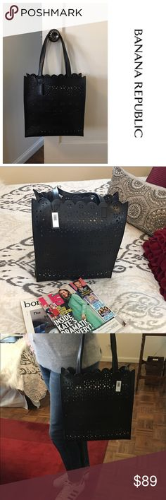 """NWT Banana Republic Portfolio Structured Tote A fun twist on a classic with this laser cut, scallop edge leather tote from Banana Republic. Perfect size and shape for work, weekend or travel. Open at the top, single interior pocket. Brand new! 13"""" H x 12.5"""" W x 5"""" D 9"""" Handle Drop Banana Republic Bags Totes"""