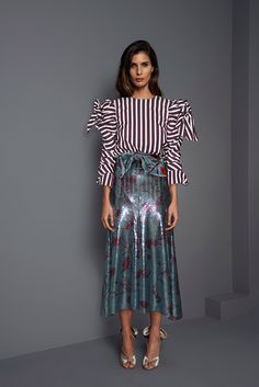 Johanna Ortiz: striped blouse, shiny skirt.