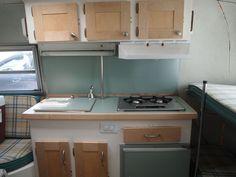 Seafoam boler kitchen, maple cabinets.