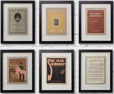Sisustustaulu kokoelmassa sarja vanhoja nuottivihkoja vitriinikehyksissä. Yhden kuvan mitat: 44 x 53 cm