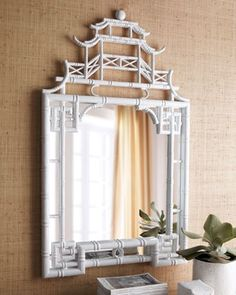 raffia wallpaper and white chinoiserie mirror