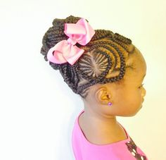 Heart cornrow design into a bun with a bow accessory. Very nice detailing in the parting!