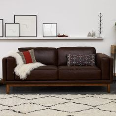 Dekalb Leather Sofa | west elm.  They finally have a good leather option plus it goes great with the rug