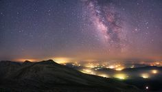 The Milky Way from the Uludag National Park in Turkey. The stunning natural spectacle hangs above manmade pockets of light from the towns and villages below