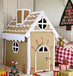 bel exemple comment construire une cabane carton pour Noel, des éléments blancs qui créent l illusion de neige