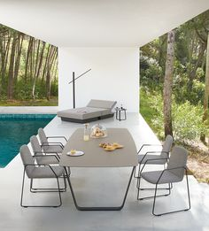 Outdoor dining chair - LOOP collection. With or without armrest, upholstered. Belgian design by Gerd Couckuyt for Manutti. Fits perfectly with the AIR table. Pool. Terrace. Garden.