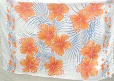 orange hibiscus white sarong beach accessories - http://www.wholesalesarong.com/blog/white-sarong-beach-accessories/