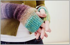 Love these fingerless gloves in Noro