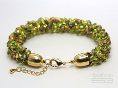 FREE SHIPPING within the USA! Chartreuse and Gold Chunky Kumihimo Bracelet. Chartreuse and gold in a textured, distinctive pattern! I used iridized gold and clear chartreuse magatama beads...along with wavy metal discs and frosted gold seed beads to create the pattern. Bullet end caps and a lobster clasp finish the bracelet. All gold-plated. Original braiding pattern by Kumihimo virtuoso Pru McRae. Kumihimo is an ancient Japanese braiding art, combining silk strands or other mater...