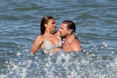 Pin for Later: It's On: New Couple Leonardo DiCaprio and Nina Agdal Show Steamy PDA on the Beach