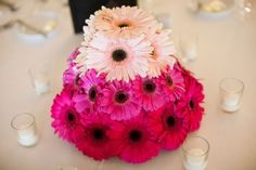 Ombre gerber daisies make a whimsical wedding centerpiece. Flowers by Ingela Floral Design.