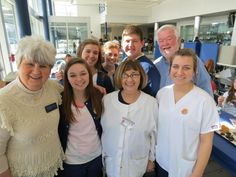 CBC's Carolyn Holland with the Allied Health class volunteers, teacher Diane Patterson & coordinator Roger Bauser. — at Fairmont High School.