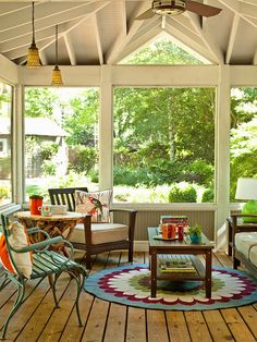 Eclectic Mission In this sunroom, simple, mission-style furniture gets a dose of personality thanks to a handful of colorful decorating touches. In one corner, a blue-painted chair contrasts the look of the other dark wood furnishings. A graphic area rug beneath the coffee table adds a splash of whimsy and helps ground the seating arrangement.
