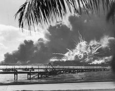 A navy photographer snapped this photograph of the Japanese attack on Pearl Harbor in Hawaii on December 7, 1941, just as the USS Shaw exploded.