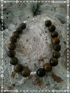 baby bracelet https://www.facebook.com/parelsenstrikjes De zoon armband uit de serie TO Armband Xavi   Babyarmband: €16.95  Kinderarmband : €18.95  Gemaakt van de tijgeroog kraal gecombineerd met sterling zilver