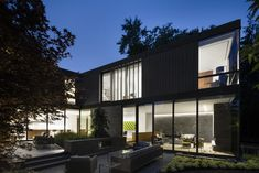 Located on a unique inside-corner lot backing onto a ravine, the house is composed to respectfully address the scale, opacity and materiality of the rich and historic streetscape in which it is placed. Toward the natu...