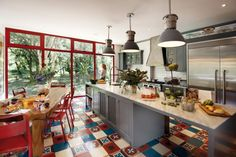 There is no denying the heart of this home. The kitchen is vibrant and pulsating with red accents, colorful tiles and an open dining space that begs for visitors to stay a bit longer and have another drink.