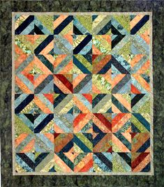 Pieceing this quilt now. Had a pkg of Bali Pops in Green Tea and didn't know what to do with it. Found this free pattern on Hoffman Fabrics website
