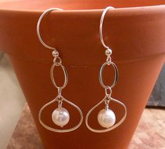 Beautiful Sterling Silver frames and White Cultured Pearl earrings.  E-232.  $35.00.  Click to view on my Etsy site or contact me directly at ByEJewelry@gmail.com.
