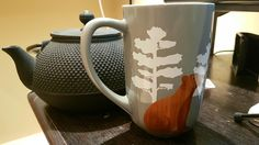 Aftermath of a good tea drinking session; cast iron pot that needs a bit of cleaning and this lovely wood graphic bear from DavidsTea.  I've been getting away from the actual tea part of David's for a little bit, but their teaware is still pretty sick.
