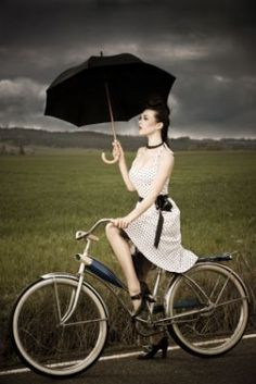 Would love to do this, but somehow I just know I wouldn't look as polished (and besides, I'd fall off the bicycle trying to hold on to the umbrella) Love those Mary Janes!