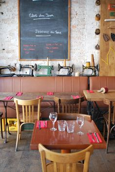 La Penderie | Paris - a wall of vintage sewing machines and sewing machine tables!