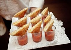 hors d' oeuvres: tomato bisque shooters with mini grilled cheese