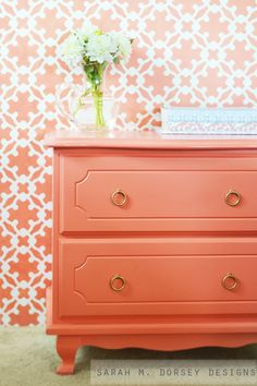 Beautifully refurbished dresser and custom stenciled wall in SW Ardent Coral by sarah m. dorsey designs