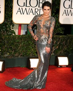 Lea Michele in Marchesa, but I can't decide.  Something is a little off, perhaps she's trying too hard.  Is this more of an Oscar gown or is she channeling her inner Cher?