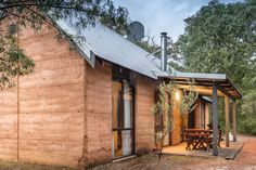 """8 well appointed rammed earth cottages, tucked away amongst peppermint & karri trees on a """"Land for Wildlife"""" property near Margaret River , Western Australia Photo: Quentin Chester Photography Peppermint Tree, Australia Photos, Rammed Earth, River House, Rustic Charm, Western Australia, Chester, Cottages, Wildlife"""