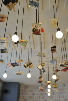 Lighting | McNally Jackson Cafe Lighting Design with hanging Scattering of Books ...