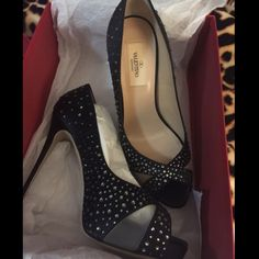 """Valentino black satin shoes 100% authentic! Brand new with the plastic covering the sole. Ladylike proportions perfect a crystallized pump set on a slim, wrapped heel and glittering with black effervescence. Approx. heel height: 4 1/2"""" with 1"""" platform (comparable to a 4"""" heel). Insole is 10"""" Long. Satin upper/leather lining and sole. Made in Italy. Retail $995.00 + Tax Valentino Shoes Heels"""