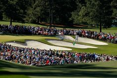 Luke Donald of England hits out of the bunker on the seventh hole during the third round of the 2012 Masters Tournament at Augusta National Golf Club on April 7, 2012 in Augusta, Georgia.