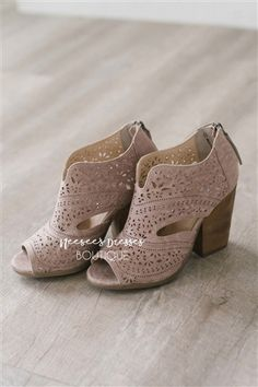Our Santana Taupe Booties are perfect for that transitional time between Winter and Spring! It features cute cut outs along the body and has a peep toe opening. Pair it with anything from our online boutique, you can't go wrong with these cuties!