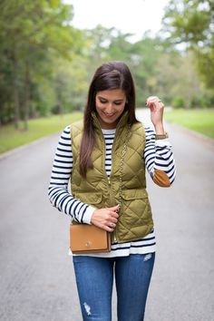stripe tee, elbow patches, elbow patch sweater, stripe sweater, distressed skinny jeans, excursion vest, tory burch wallet on a chain, brown booties, fall fashion, preppy fall outfit // grace wainwright from a southern drawl