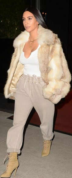 Who made  Kim Kardashian's tan lace up boots, sweatpants, and gold jewelry?