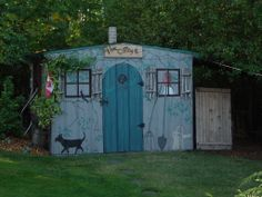 "Folky Shed Art!  we turned our ugly grey metal shed into something ""a bit"" better...had fun doing it anyway!"