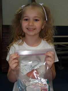 """I love watching our Kindergartners celebrate 100 days of school!  They celebrate by bringing in 100 items to count and share with the class.  In addition to her """"share"""" items this little cutie presented me with 100 Box Tops!  <3 it!"""