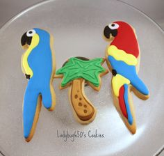 Parrot and palm tree cookies, handmade & iced - One dozen. $28.00, via Etsy.