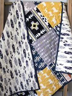 This quilt is completed and ready to ship to you! This modern baby boy quilt is made using a mix of rustic woodland fabrics and modern tribal